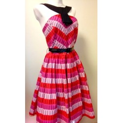 Pink 1950s style dress with black belt
