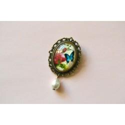 Roosi, liblika ja pärliga vintage pross